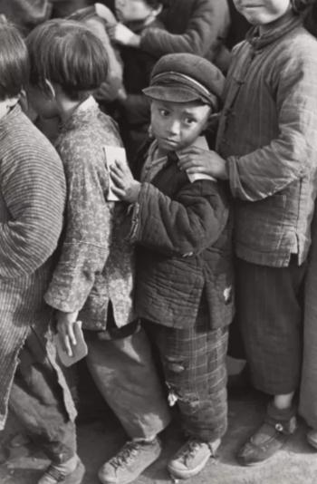 Children await rice distribution, Shanghai, China 1949